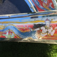 A mermaid on the side of one of the seat buckets.